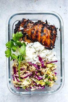 Korean Chicken Meal Prep Bowls with Boneless Skinless Chicken Thighs, Jasmine Rice, Slaw Mix, Low Sodium Soy Sauce, Rice Vinegar, Honey, Sesame Oil, Ginger, Low Sodium Soy Sauce, Honey, Ginger, Garlic, Sesame Oil, Sesame Seeds.