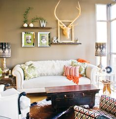 Modern eclectic living room. Explore a potpourri of styles. A new sofa is perfectly at home with an Asian chest repurposed as a coffee table. The white chair is a reupholstered vintage store find.