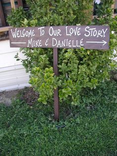 Personalized Your Name on Wood Country Wedding Sign on Stake Welcome To Our Love Story Directional Arrow. $35.00, via Etsy.