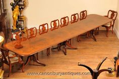 http://canonburyantiques.com/s/dining-tables/regency-dining-tables/1/  This one's a big un' - sixteen feet Regency pedestal dining table in walnut with matching Queen Anne chairs. Large range of other Regency dining tables available.