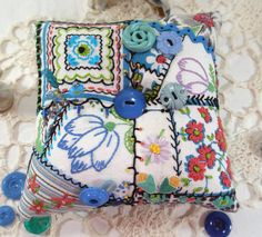 Pincushion, Hand embroidered fabrics, feed sacks and vintage quilt blocks make up this pretty crazy patch pincushion.