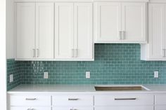 Using a solid, teal will also be beautiful with the countertop.  The countertop will bring in the beach, and this color brings in the bright beachy green/blues!