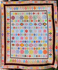 Disappearing 9-Patch quilt 38 x 50 inches Blocks made by FLE group members completed 1 January Laughing All the Way 42 x 42 ...