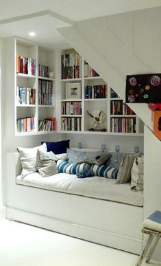 cozy space to relax while enjoying a book : reading nook under stairs with book collections Staircase Storage, Stair Storage, Book Storage, House Staircase, Staircase Design, Closet Storage, Diy Storage, Home Design, Home Interior Design