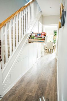 Space-creating ideas: Hallways Make the most of your under-stairs area with this stylish and practical idea. Create a secret hideaway with a pull out drawer, [. Staircase Storage, Clever Closet, Staircase Design, Hallway Storage, Hallway Flooring, Loft Design, Under Stairs Cupboard, Hallway Designs, Stairs