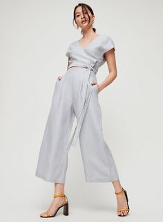 The Brax is made with a soft linen blend that's light and airy — great for rising temperatures. The wrapped bodice defines your waist, while the cut-out detail gives the illusion of a two-piece design. Short Jumpsuit, Jumpsuit Dress, Rompers Women, Jumpsuits For Women, Grey Jumpsuits, Wedding Outfits For Women, Wedding Attire, Wedding Jumpsuit, Cool Fabric