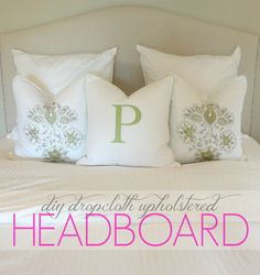 9. Build your own headboard. Because those things can be pricey. I made mine with a piece of plywood, upholstery foam, a drop cloth (used as the upholstery material), and some silver nailhead trim. In total, I think it cost me less than $50.