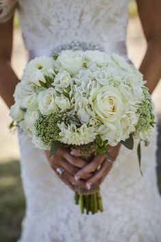 Bride's Bouquet Arranged With: White Roses, White Spray Roses, White Hydrangea, White Dahlias, Green Queen Anne's Lace, Greenery & Foliage