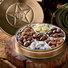 The holidays just got a little bit sweeter with this beautiful tin of select pecans. This personalizeable tin includes seven different coatings: honey, praline, dark chocolate, butter roasted, chocolate, double-dipped, and cinnamon. | King Ranch Saddle Shop