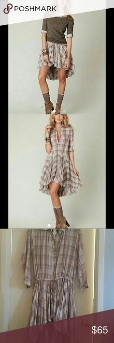 Free people one shirt dress Pretty in plaid! Hard to find dress! Button up shirt dress with ruffled high low hem and 3/4 length sleeves. Features drawstring waist for adjustable fit. 100% cotton. Looks cute solo or even over jeans and leggings. Free People Dresses Midi
