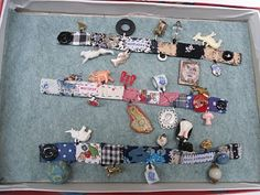 Julie Arkell, I loved these little what? charm? bracelets... These were made of a variety of little strips of fabric with all sorts of oddments (rammel!) attached. I've nearly finished the fabric part - I just need to find some bits with little loops for attaching. Julie seems to have used cracker toys and all sort of other bits -if you can think of anything appropriate please let me know! As the items are attached to fabric they need to be quite light.