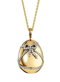 Faberge Egg pendant in gold with tiny diamonds...