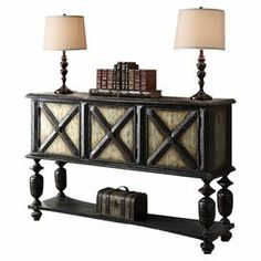 """Three-door server with heavy turned legs and a bottom display shelf. Doors feature a raised X pattern.  Product: ServerConstruction Material: WoodColor: Dark brown, gold and silverFeatures:  Three doors with an """"X"""" designOne tapered shelf Dimensions: 37.25 H x 58.25 W x 16 D"""