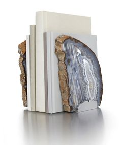 Fim Bookends - Natural Agate - Pared-down styling contrasts with the inherent complexity of authentic semiprecious gemstone in the Fim Natural Agate Bookends, striking and sculptural displays of genuine Brazilian stone polished to a lovely, pattern-displaying gleam and mounted into a beautifully-paired duo of useful home art pieces. The glossy neutrals of the agate complement transitional décor perfectly.