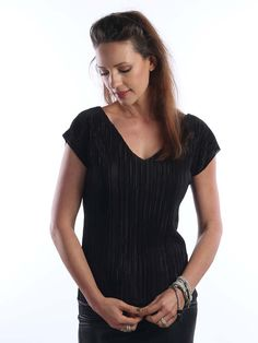 Sexy Black pleated shirt, made of lycra, with V neckline. Features: ********* √ Made of pleated lycra √ V neck √ elegant look Sizes: (Model wears size S) ****** S - Chest- cm) Hem - M - Chest - 36 Hem - 38 cm) L - Chest - 38 cm) Hem - 40 cm) XL - Chest - Summer Fashion Outfits, Holiday Outfits, Pointed Heels Outfit, Pleated Shirt, Event Dresses, Wedding Dresses, Short Sleeve Blouse, Casual Tops, Blouses For Women