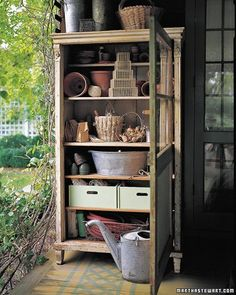 A vintage wooden cupboard provides handsome storage for gardening supplies. Perched on the front porch, it serves as a way station between house and garden.