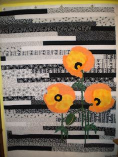 Love this quilt - black and white patterned jelly roll with a pop of color in the quilted flowers. But I would do bold pinks or red instead of orange. Quilting Tutorials, Quilting Projects, Quilting Designs, Quilting Patterns, Quilting Ideas, Jellyroll Quilts, Scrappy Quilts, Rag Quilt, Baby Quilts
