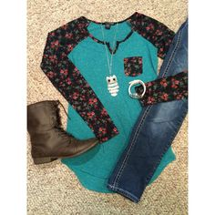 Floral print baseball tee Very pretty turquoise baseball style shirt with floral print sleeves. Is in great condition, I only wore it once or twice.  Size is L but fits S best, imo. American Dream Tops Tees - Long Sleeve