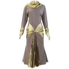 Preowned Iconic Vintage Thierry Mugler 1980s Grey Jersey And Gold Lame... (5,945 CAD) ❤ liked on Polyvore featuring dresses, cocktail dresses, grey, gold lame dress, gray cocktail dress, gold dress, long sleeve cocktail dresses and long sleeve dress