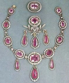 The Pink Topaz Demi-Parure consists of a necklace with three pendants, a large corsage brooch and a smaller one. The stones are set in a millegrain setting. The set was a present from Tzar Paul I of Russia to his daughter Maria on occasion of her marriage to Grand Duke Friedrich of Saxe-Weimar Eisenach in 1804. She in turn gave the set to her daughter Augusta (German Empress), who later presented it to her daughter Louise, mother of Queen Victoria of Sweden