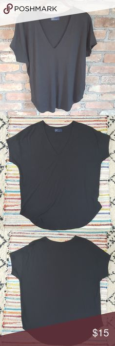 Gap Dolman Sleeve Tee Black dolman sleeve tee.  Last 3 pics most accurately depict the color - there is no fading.  Loose fitting top.  V-neck.  Split sides.  Super soft material. GAP Tops Tees - Short Sleeve