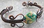 Nancy Wickman's free tutorial on how to make a woven wire bracelet.
