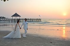 Maggie wearing our beautiful lace covered ivory gown at her beach wedding in Sihanoukville, Cambodia.