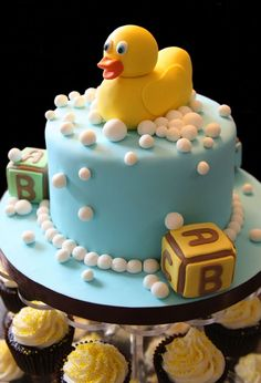 rubber ducky cake....blocks could go really cute with the each guest create a building block idea