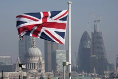 Union Jack over the city of London with a view of St. Paul's, The Gherkin and The Shard which is under construction