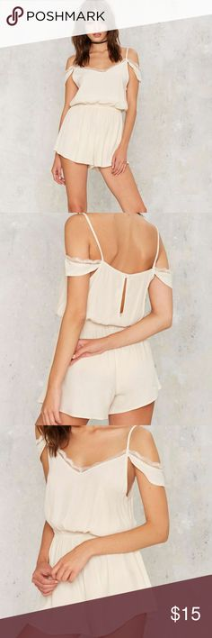 nasty gal Romeo Cold Shoulder Romper new with tags medium  Hello, lover. The Romeo Romper is made in ivory crepe and features a lace trim, cold shoulder design, and elastic waistband. Unlined.  *Rayon  *Runs true to size purchased at nasty gal brand is audrey Nasty Gal Pants Jumpsuits & Rompers