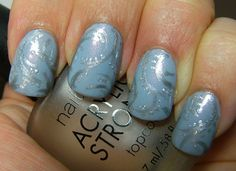 Winter blue and silver nail design.
