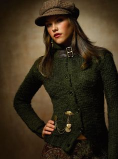 I love the hat. I like the green sweater as well, but I would use it as a layer over something else.