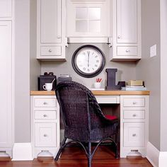 n this cozy kitchen office, built-in Shaker-style cabinets provide plenty of storage and conceal outlets for charging phones and other electronics. The large desk area allows the homeowner to do work comfortably in her own kitchen. F