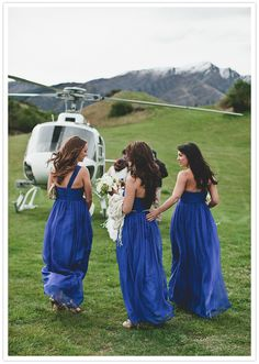 cobalt blue, floor-length bridesmaid dresses; these are so cute and the color is lovely! Also I might be biased because of the helicopter :)