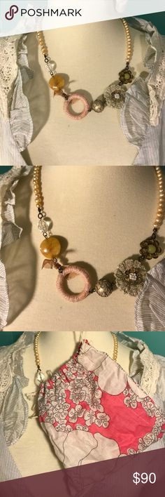 Gorgeous anthropologie pearl ribbon necklace Worn twice. Absolutely gorgeous! Was always too afraid I'd break it and just kept it around because it was pretty. It needs some love and to be shown around :) delicate lace and intricate details. Comes with extra pearls Anthropologie Jewelry Necklaces