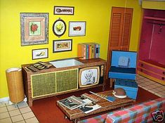The living room of Barbie's Dream House, 1962. My favorite feature was the stereo console. It even came with little album covers by the Kingston Trio.