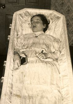 younger lady in her casket