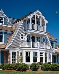 Dutch Colonial luxury home on the coast. Visit Design Nashville's Coastal Living Collection of home accents, bedding, and draperies.