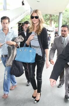 Leather pants, cardigan Rosie Huntington-Whiteley casual look