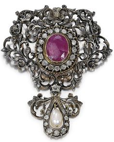 SILVER, GOLD, RUBY, DIAMOND AND PEARL BROOCH, 19TH CENTURY.