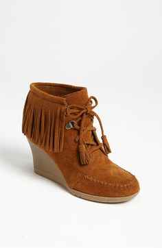 as if i need more mocs but these have wedges..    Minnetonka Lace-Up Fringe Ankle Boot | Nordstrom