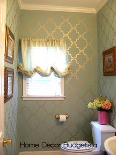 REALLY love this blue wall with the light gold stencil over top!
