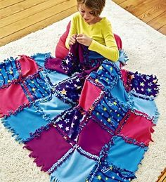A variation on the no-sew knotted fleece blankets. Would be really cute with a solid, coordinating color on the reverse.
