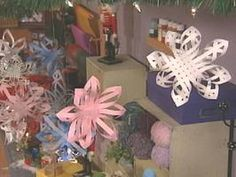 How to Make Woven 3-D Paper Snowflakes.  My boyfriend's mom showed me one of these that someone gave her.  The photos here don't begin to do these things justice.  The one I saw was made with 2-sided paper (probably scrapbooking or card-making stock of some sort).  It was stunning!