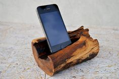 Beautiful iPhone station handmade from gorgeous oak wood. The stand fit to iPhone 4, iPhone 5 and phones with similar sizes. Being hand-made, each item is one of a kind.  Add a touch of nature to your workspace or home with a natural wooden iPhone Station.  Size approximately: Length: 15 cm (5,85 in.) Width: 10 cm (3.90 in.) Height: 7 cm (2.73 in.)