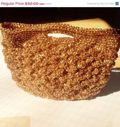 A personal favorite from my Etsy shop https://www.etsy.com/listing/227617627/vintage-gold-handbag-plastic-nylon-wires