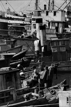 Ara Guler TURKEY. 1958. Bargeman catching fish at the repair wharf.