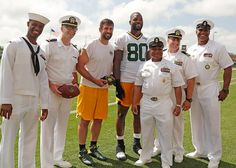 Aaron and Marty Bennett meeting some of the men who serve in the Navy!