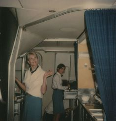 August 3, 1976  two flight attendants prepare in the first class galley of a 747  prior to customer boarding of Pan Am flight 106 from Washi...