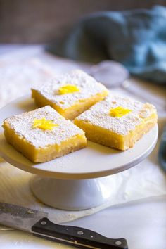 Classic lemon bars with a luscious lemon filling and a buttery shortbread crust. An easy bakery recipe for making lemon squares from scratch. Best Potluck Dishes, Potluck Recipes, Bakery Recipes, Easter Recipes, Dessert Recipes, Cooking Recipes, Drink Recipes, Summer Recipes, Appetizer Recipes